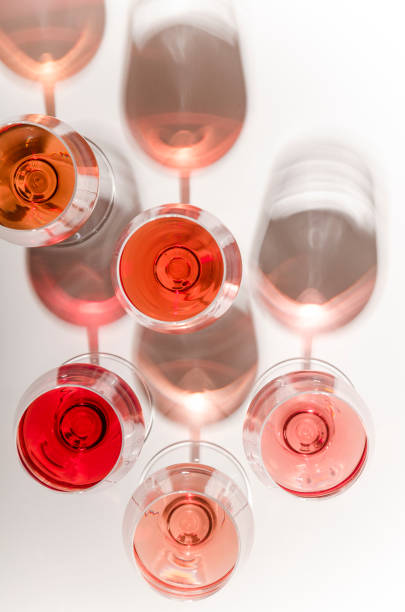 Glasses of white and pink wine with their shadows picture id1028386758?b=1&k=6&m=1028386758&s=612x612&w=0&h=ewm97fzhqqlfcwi1lo0do0dbslssztqoefun0a806w4=