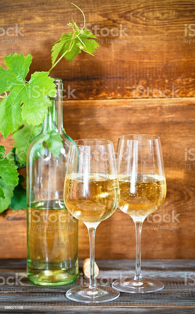 Glasses of white and red wine with grapes stock photo