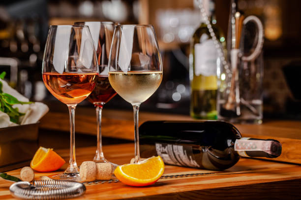 Glasses of white rose and red wine are on the table a bottle and are picture id1153776904?b=1&k=6&m=1153776904&s=612x612&w=0&h=xz6ktaz7ofwx6apk7ghys5emshkbtezbnc8ncjpxzbu=