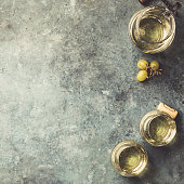 istock Glasses of white sparkling wine on rustick background 1136422903