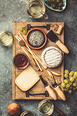 istock Glasses of white sparkling wine with cheese, grapes, nuts , olives and honey 1079600934
