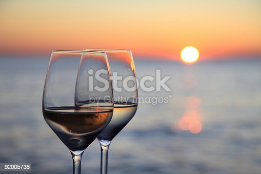 istock Glasses of wine against red sunset 92005738