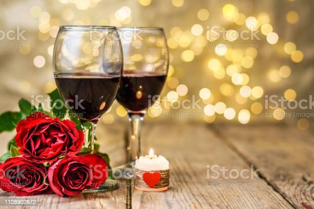 Glasses of wine roses and burning candle picture id1128902672?b=1&k=6&m=1128902672&s=612x612&h=ep1kkewcy67b11lyufeefppoqc5sm9ylbgobsinzoe0=