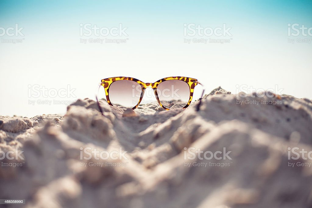 Glasses on a beach royalty-free stock photo