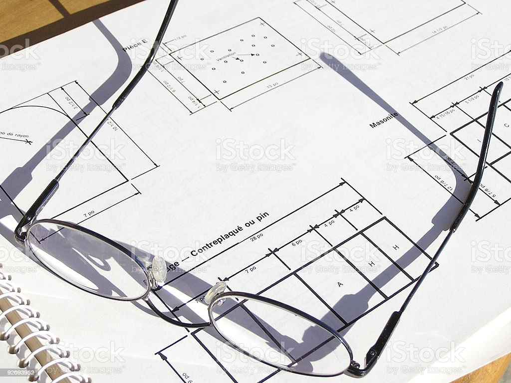 Glasses on a blueprint royalty-free stock photo