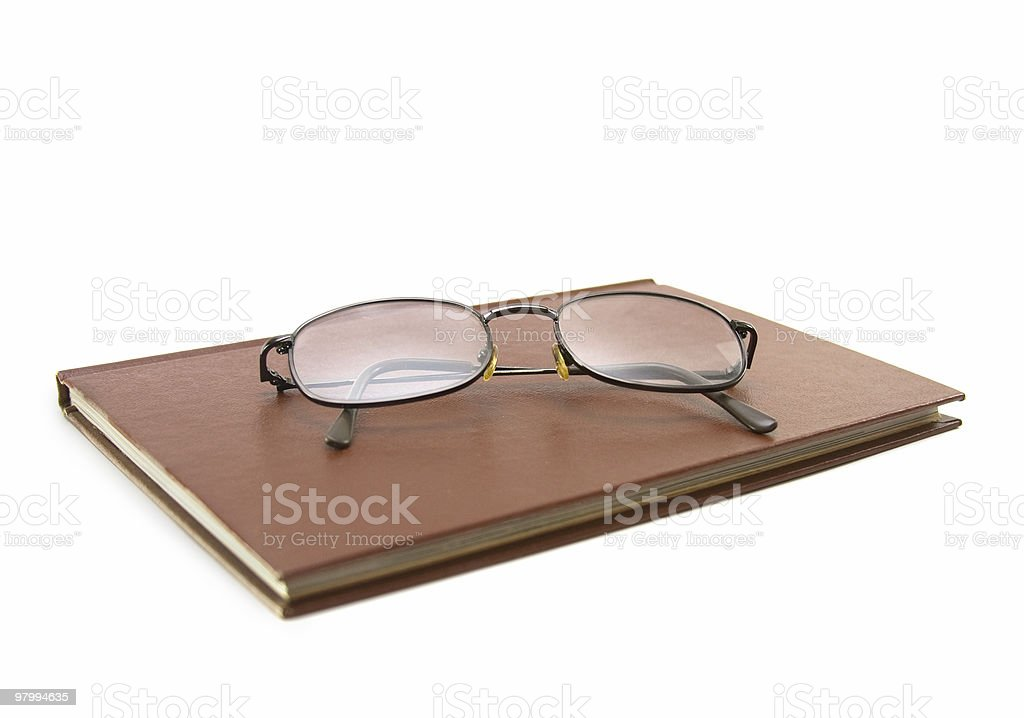 Glasses on a Brown Book royalty free stockfoto
