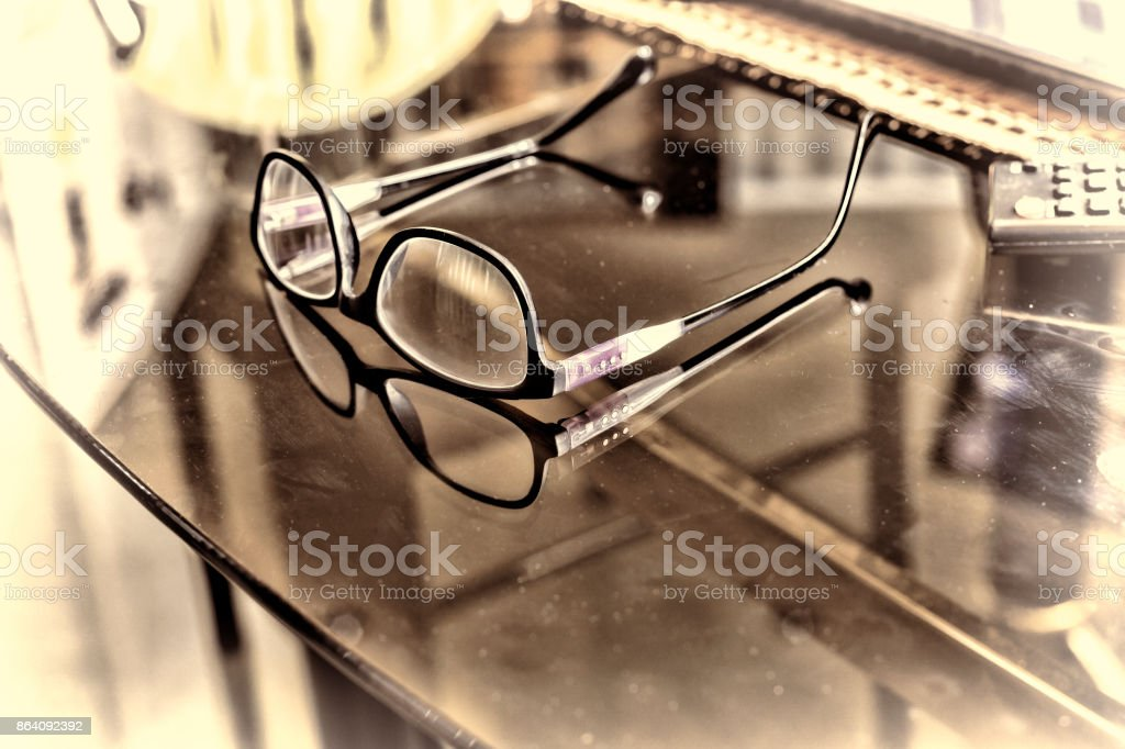Glasses on a desk in the office. royalty-free stock photo