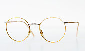 Golden color glasses on a white background.
