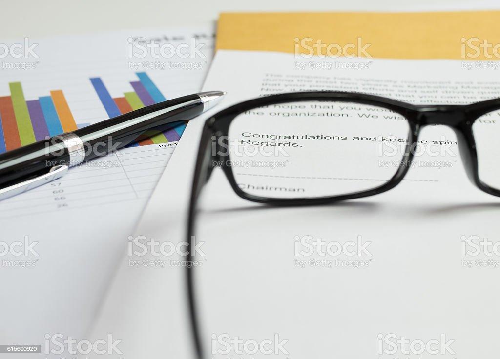 Glasses on congratulations letter stock photo