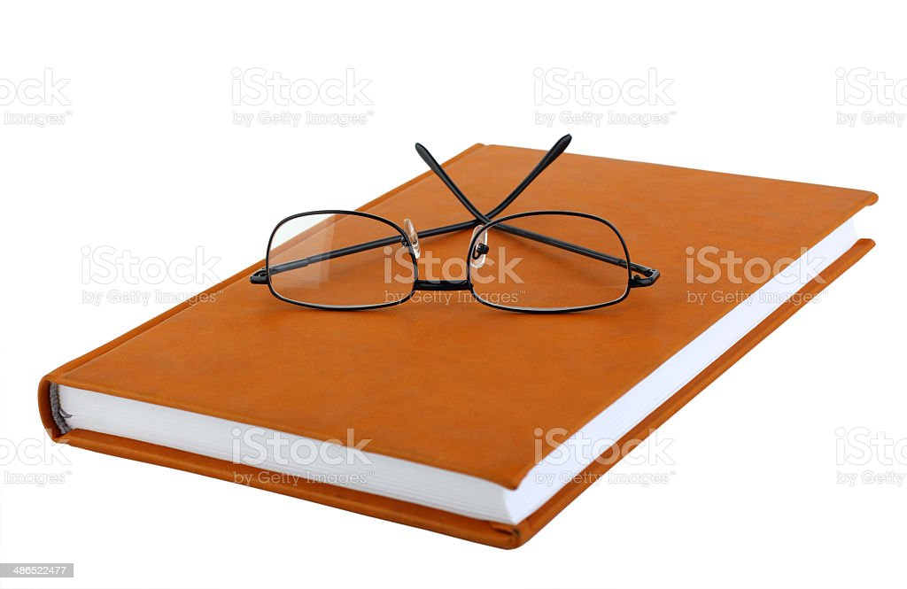 Glasses on diary royalty-free stock photo