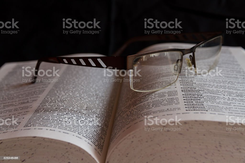 Glasses on dictionary - Royalty-free Book Stock Photo