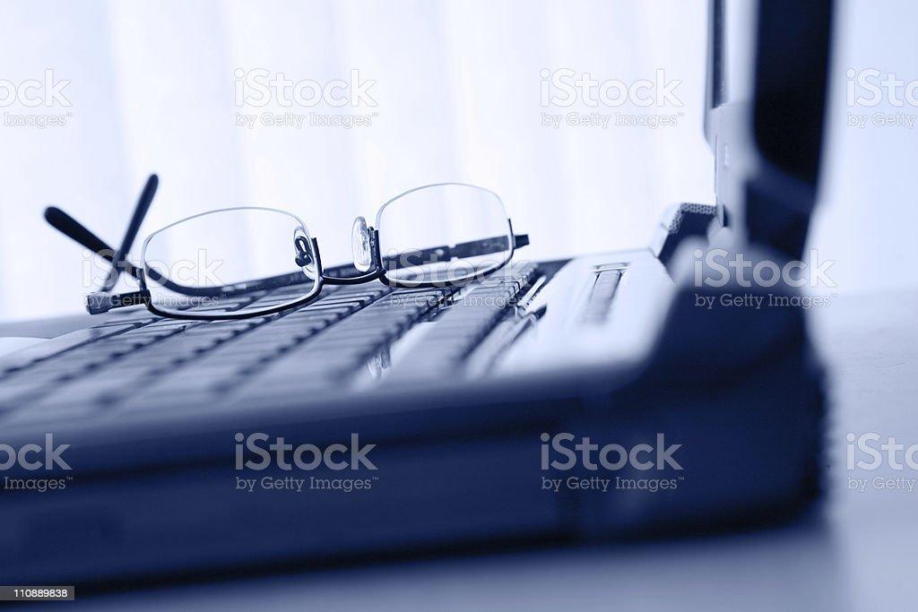 Glasses on Keyboard royalty-free stock photo