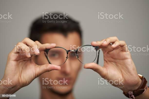 Glasses on man hands picture id854349446?b=1&k=6&m=854349446&s=612x612&h=cpf ji0oylgozijqmmofdfjemxqavmnnxqoh48opeaw=