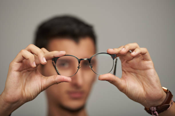 Glasses on man hands stock photo