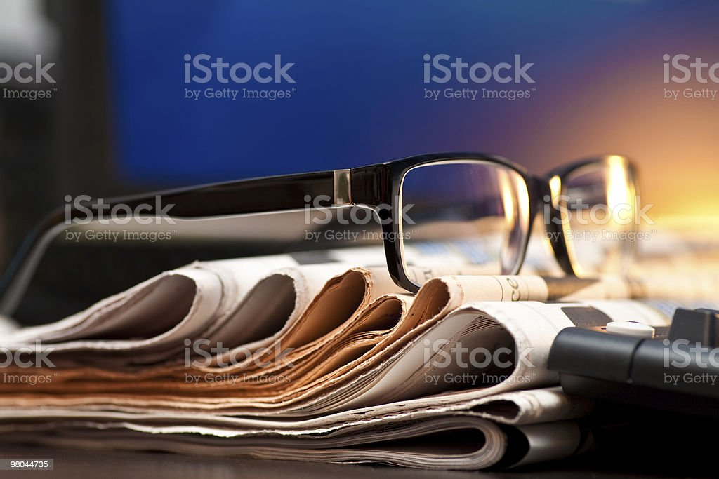 Glasses on newspapers royalty-free stock photo