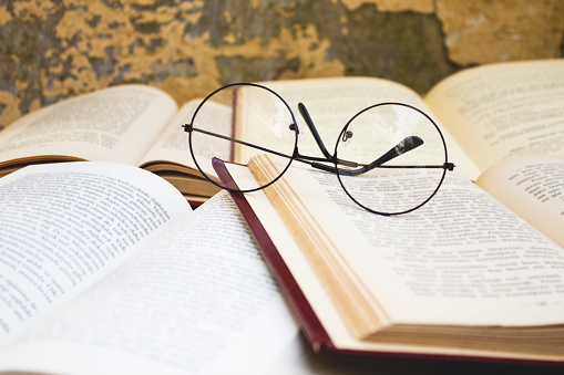 Glasses on old books. Close up.