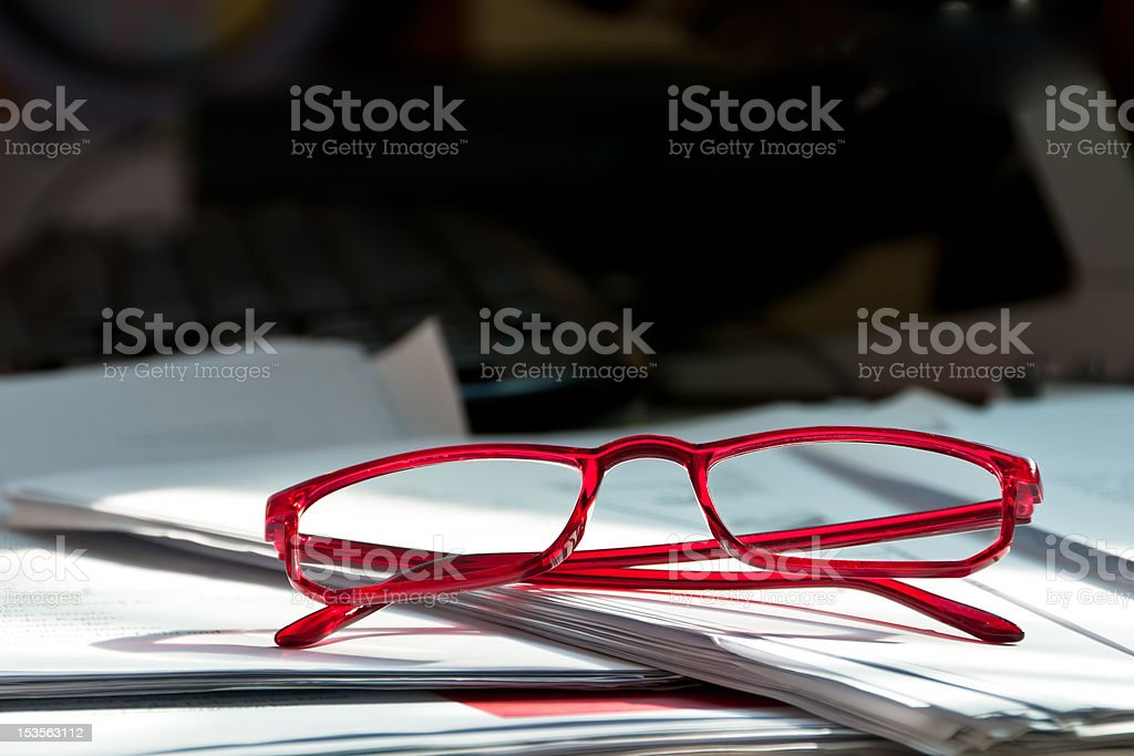 Glasses on paper documents stock photo
