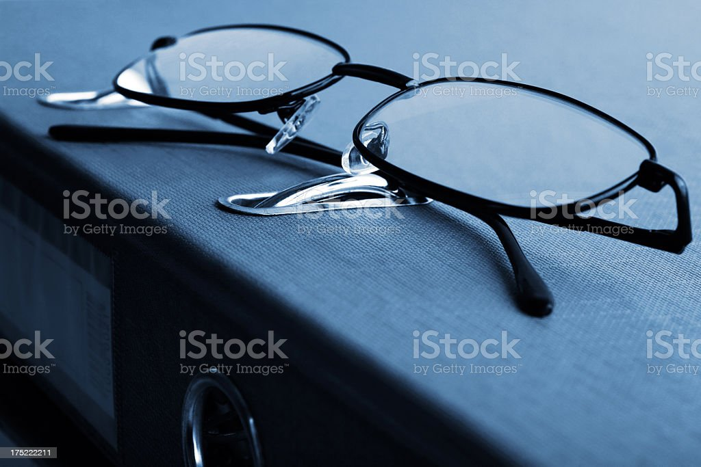 Glasses on ring binder royalty-free stock photo
