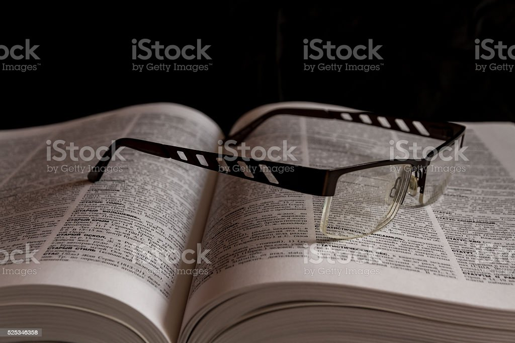 Glasses on Russian Cyrillic dictionary - Royalty-free Book Stock Photo