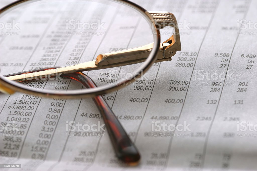 Glasses on stock list royalty-free stock photo