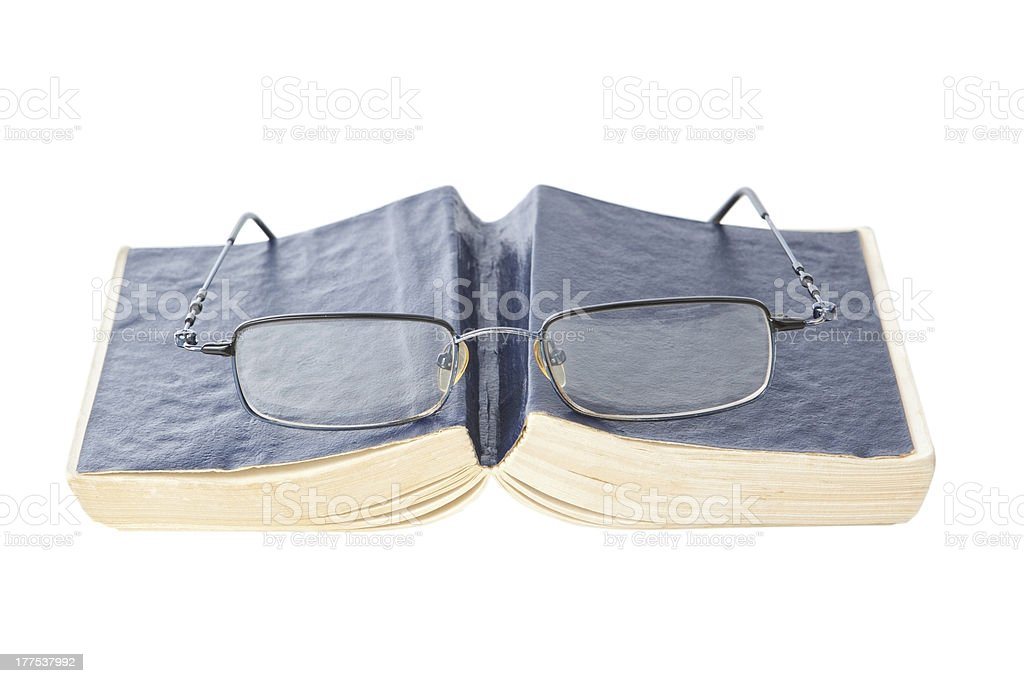 Glasses on the book, closeup. royalty-free stock photo