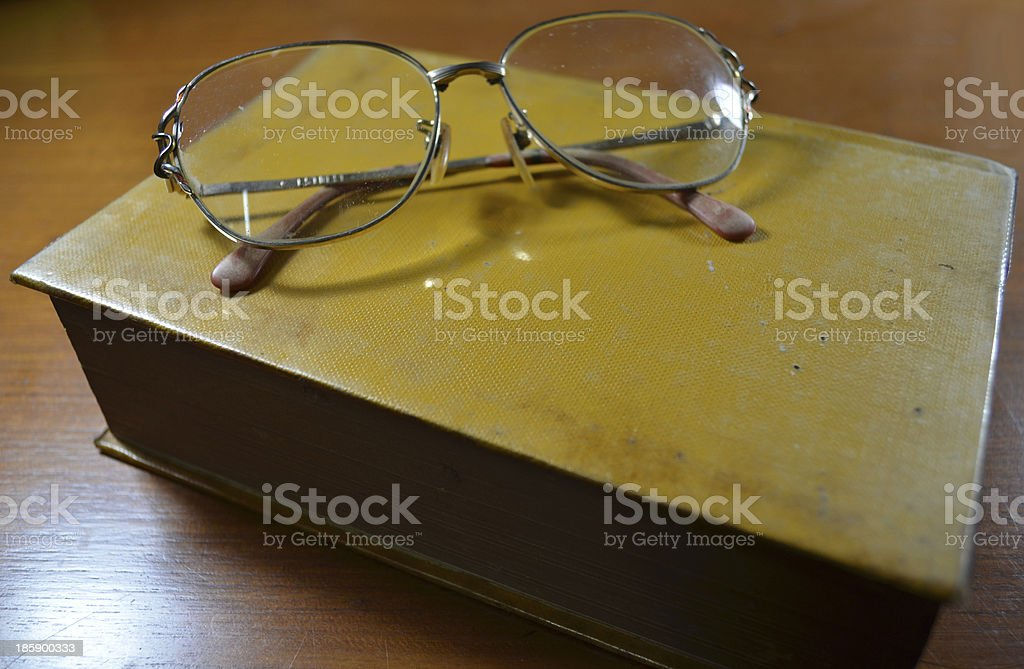 Glasses on the old book royalty-free stock photo
