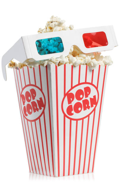 3D glasses on top of a popcorn box 3D glasses on top of a popcorn box isolated on white background 3 d glasses stock pictures, royalty-free photos & images