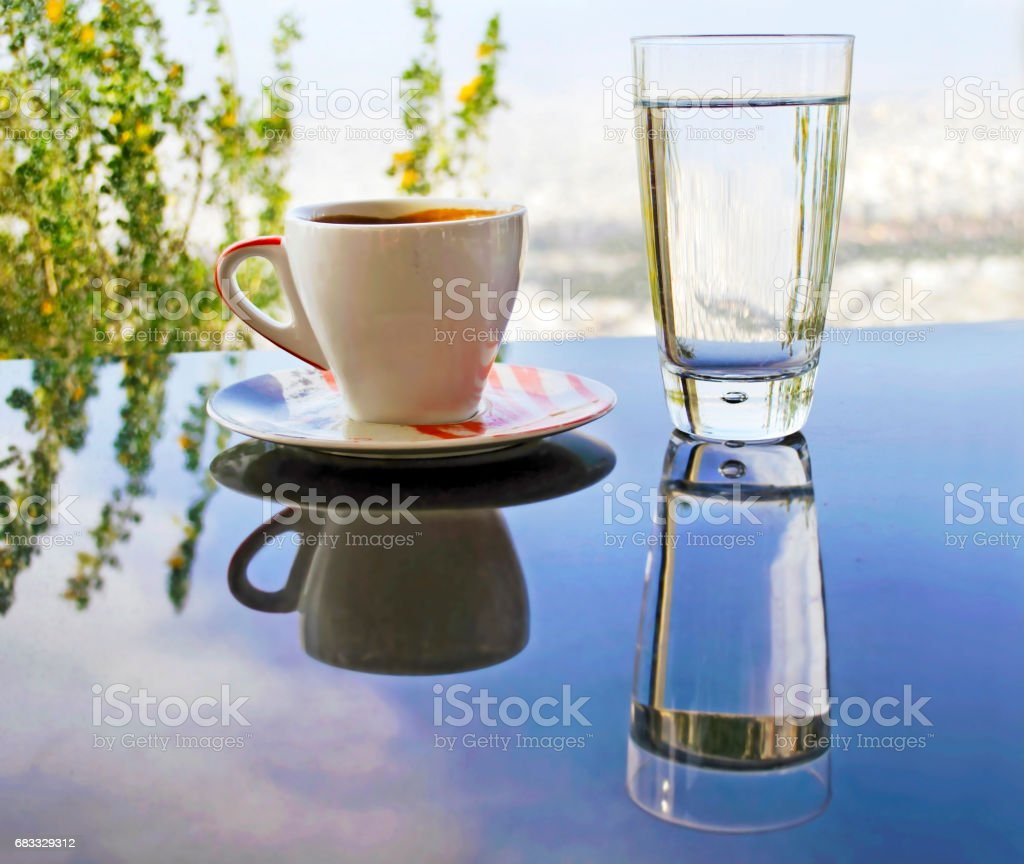 glasses reflections on the table - cup of cappuccino stock photo
