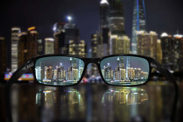 85431252b8 Royalty Free Night Cityscape Focused In Glasses Lenses Pictures ...