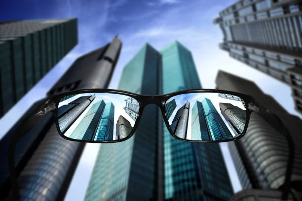glasses, vision concept, skyscrapers - diminishing perspective stock photos and pictures
