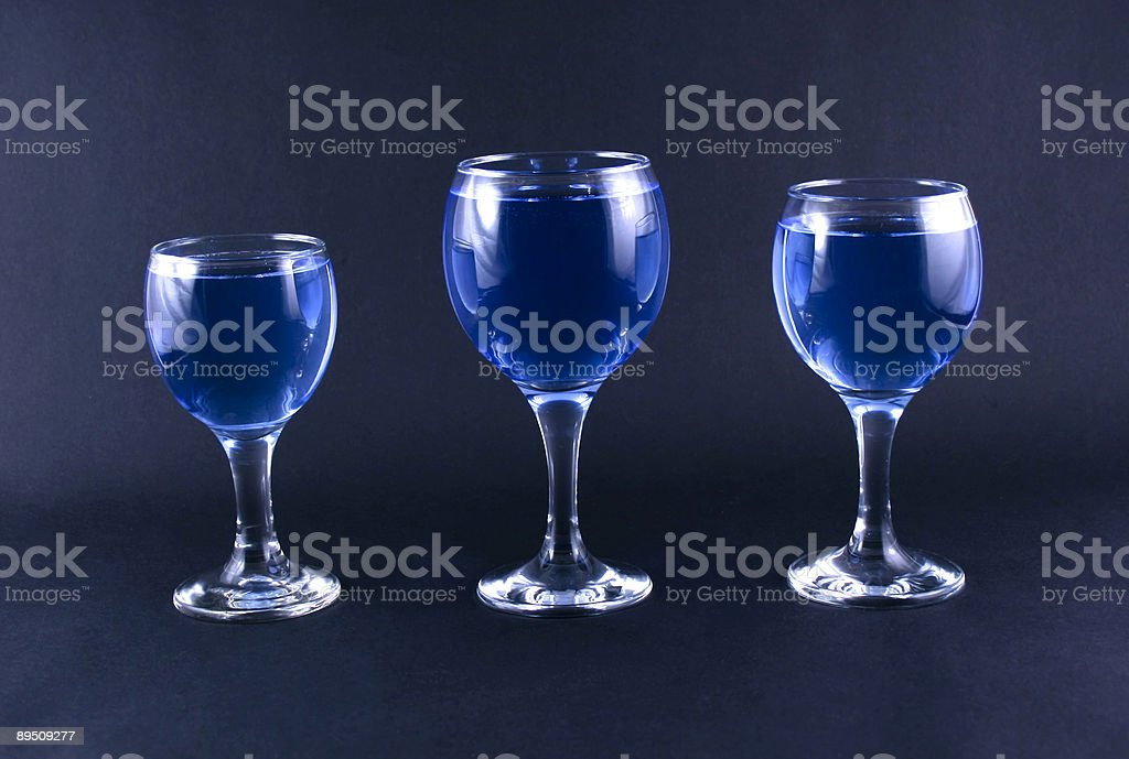 Glasses with a blue drink royalty-free stock photo