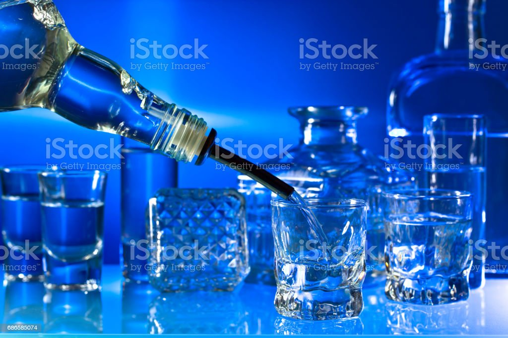 Glasses with alcoholic drinks on a glass table in bar royalty-free stock photo