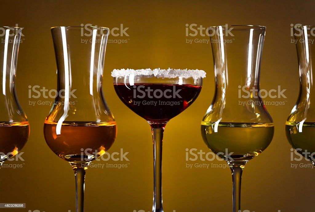 Glasses with alcoholic drinks stock photo