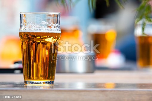 istock Glasses with beer on the coffee table. 1166174484