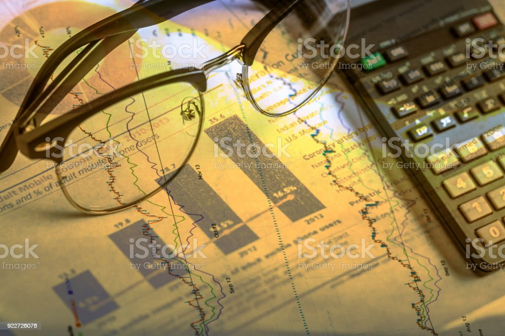 glasses with calculator and report document stock photo