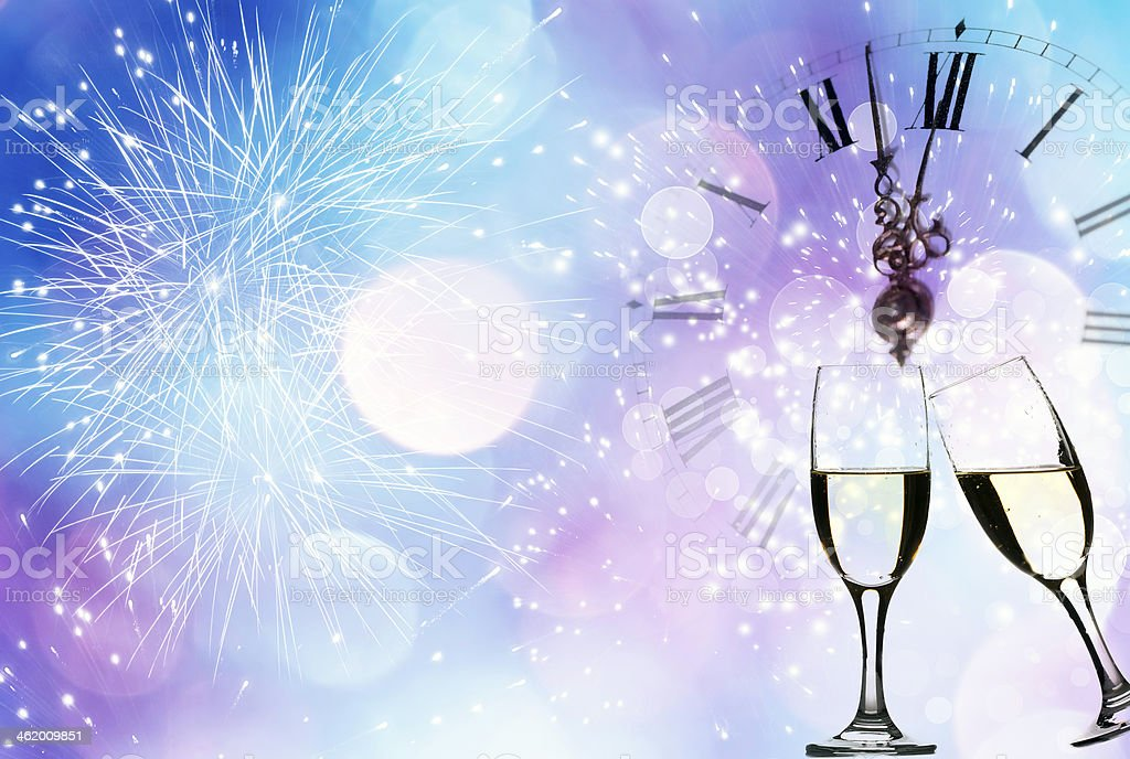 Glasses with champagne against fireworks and clock royalty-free stock photo