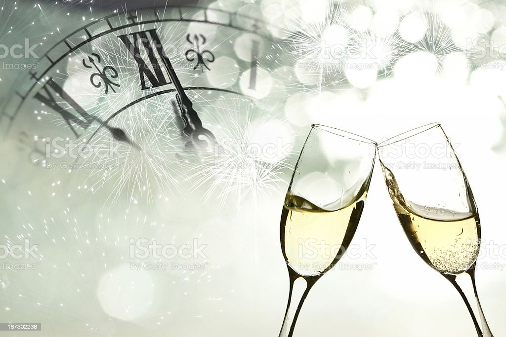 Glasses with champagne against fireworks royalty-free stock photo