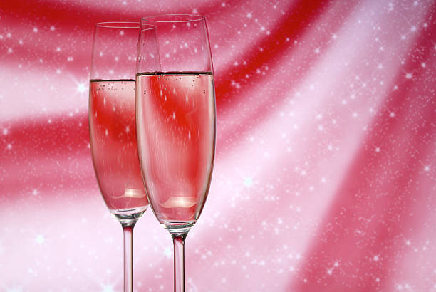 Glasses with champagne  on an abstract background stock photo