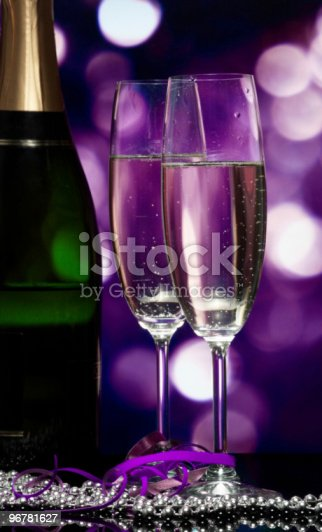 istock Glasses with champagne on an abstract background 96781627