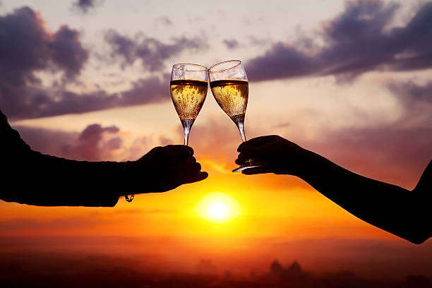 Glasses with champers at sunset stock photo
