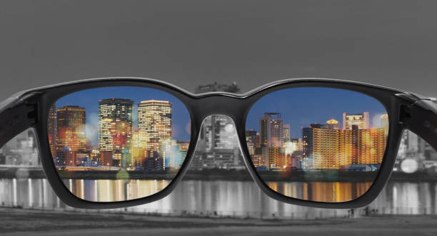 Glasses with city view, selected focus on lens, Color blindness glasses, Smart glass technology stock photo
