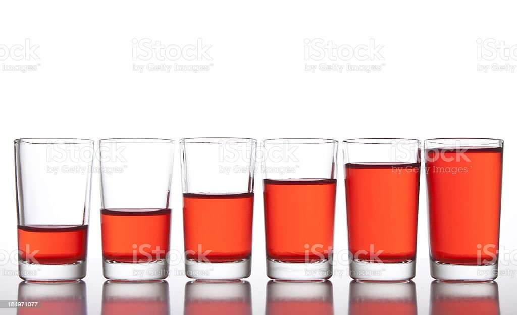 Glasses with different level of drink stock photo