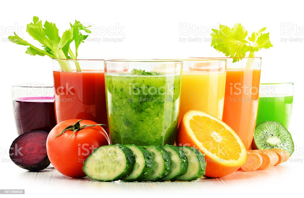 Glasses with fresh organic vegetable and fruit juices on white royalty-free stock photo