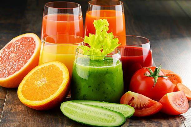 glasses with fresh organic vegetable and fruit juices - holistic medicine stock photos and pictures