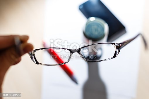 istock Glasses with glasses on a white background and a stamp on the print with a fountain pen, paper background 1051128270
