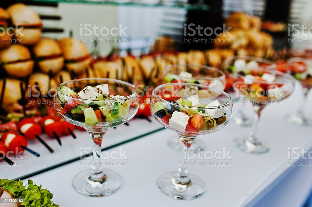 Glasses with Greek salad on reception stock photo