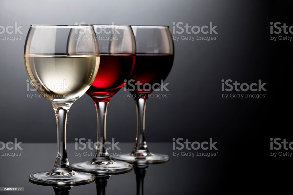 Glasses with red, white, rose wine stock photo