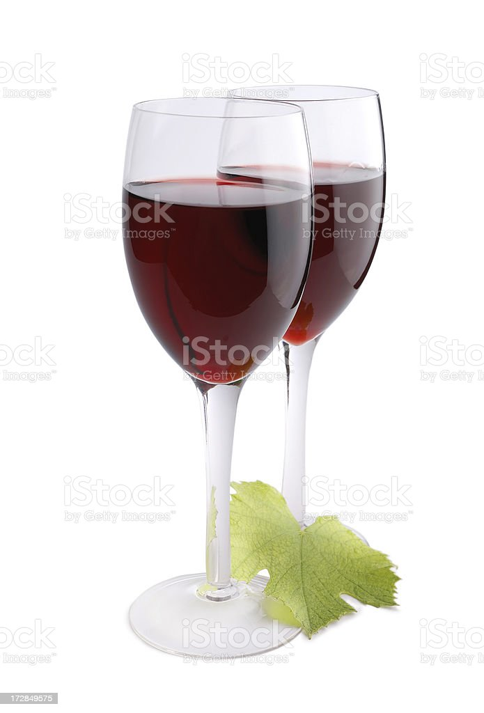 Glasses with red wine and grapes leaf royalty-free stock photo