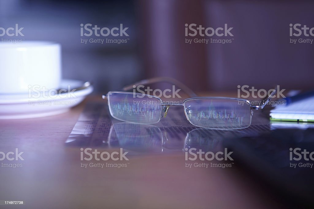 Glasses with reflected charts on table. royalty-free stock photo