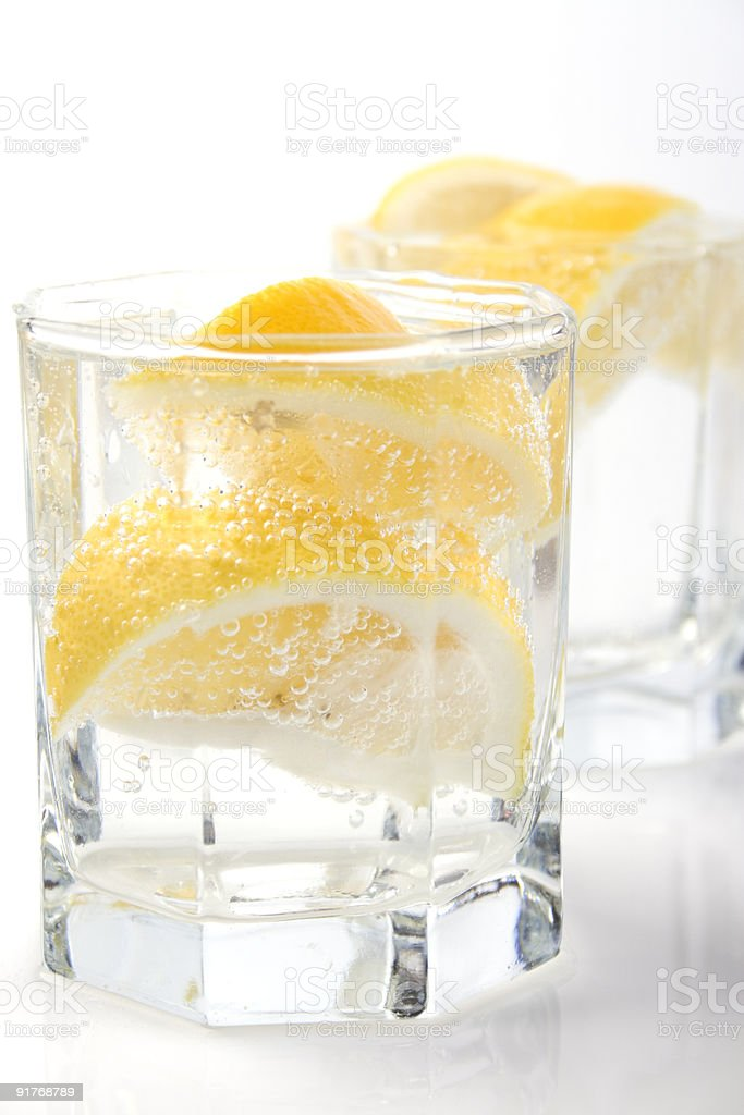 glasses with soda water and lemon royalty-free stock photo